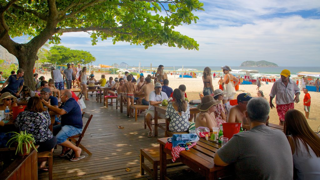 Barra da Tijuca which includes a sandy beach as well as a large group of people