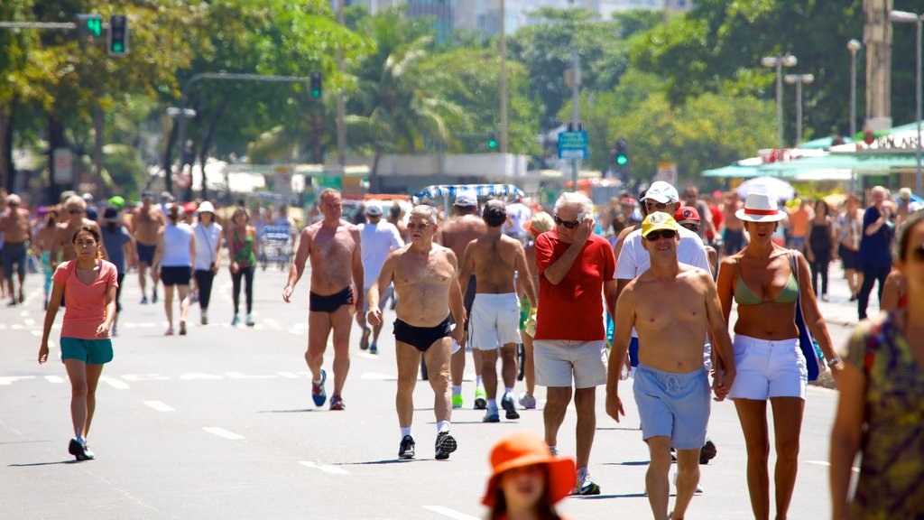 Copacabana Beach showing street scenes as well as a large group of people