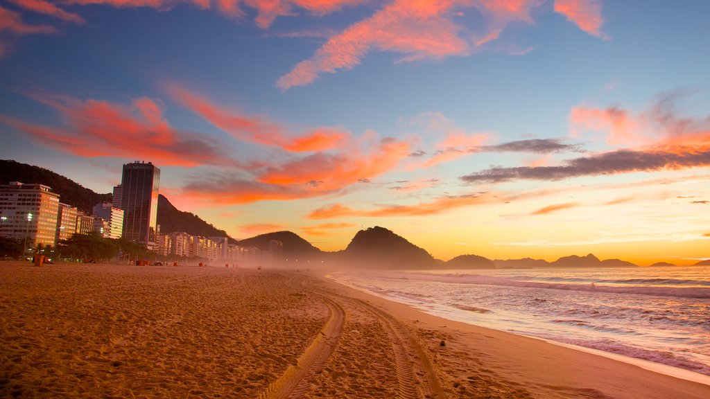 Copacabana Beach which includes a sandy beach, a sunset and general coastal views