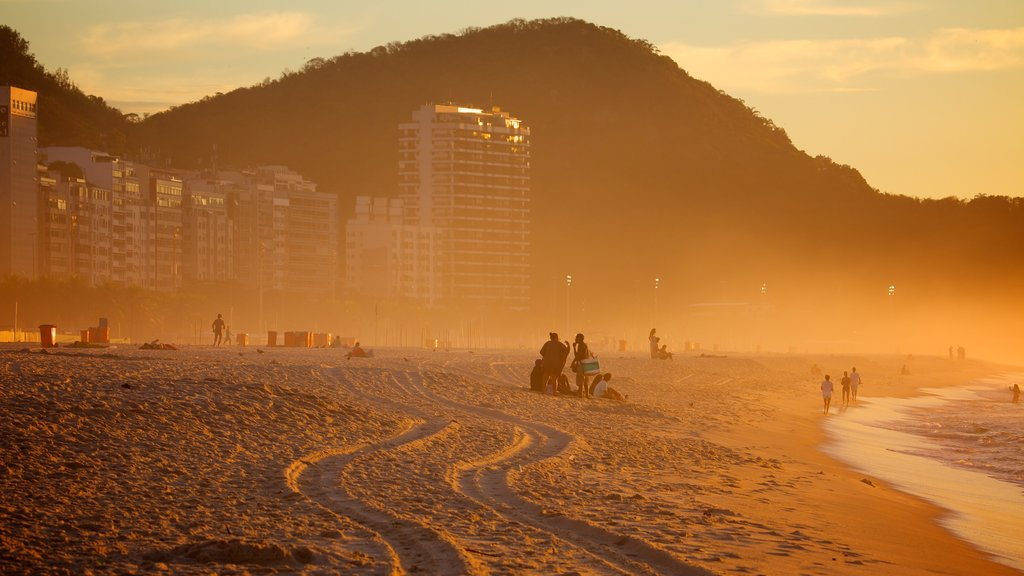 Copacabana Beach featuring a sandy beach and a sunset
