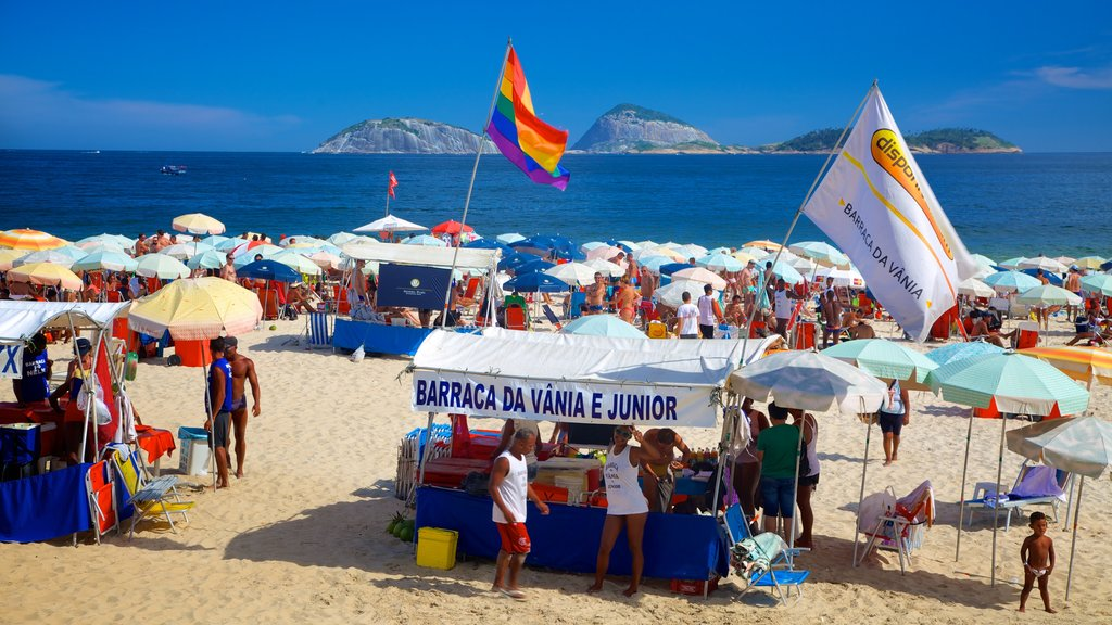 Ipanema Beach showing a sandy beach and signage