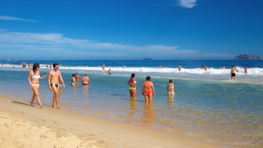 Ipanema Beach featuring a sandy beach as well as a small group of people