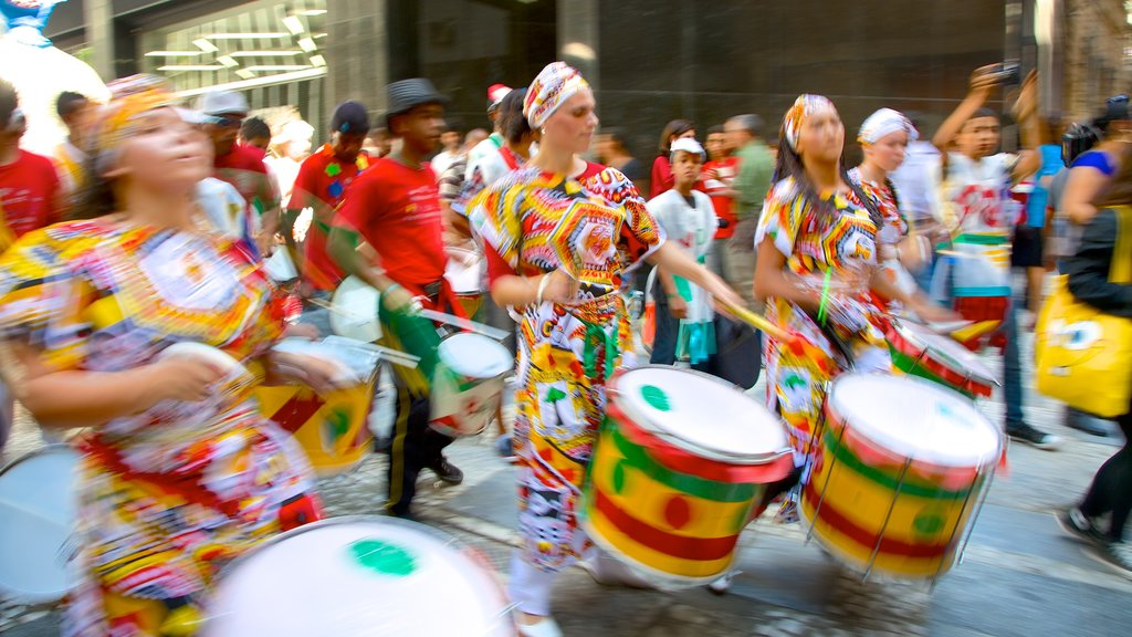 Sao Paulo showing street performance as well as a large group of people