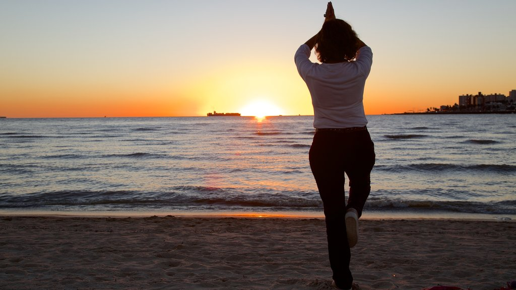 Montevideo showing a day spa, a sunset and a sandy beach