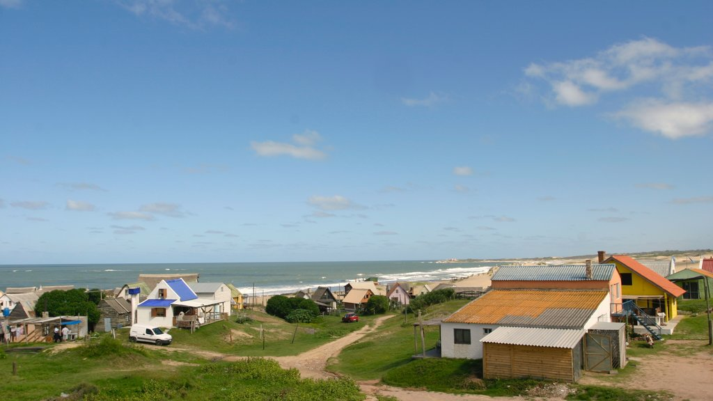 Punta del Diablo showing a coastal town and a house