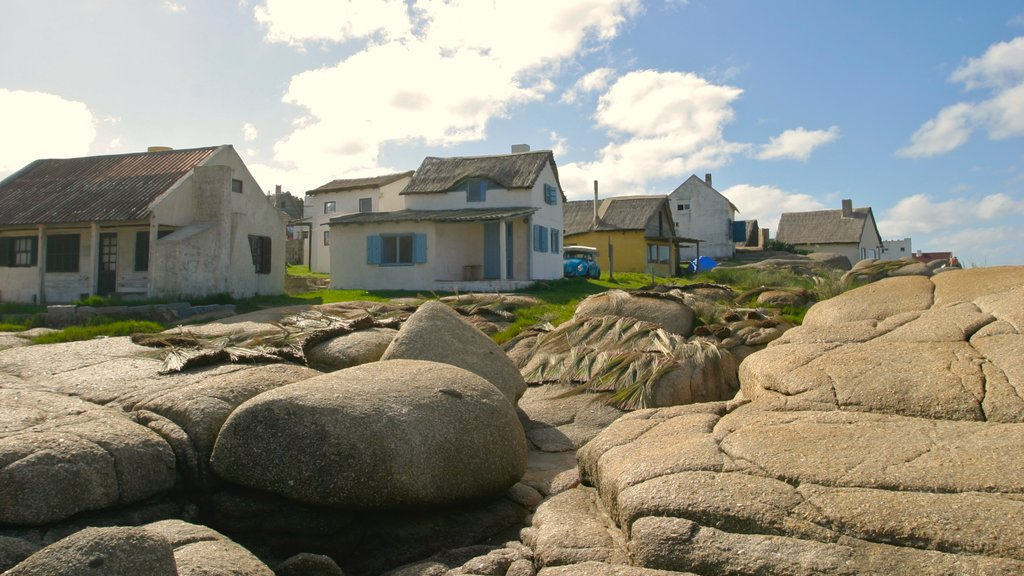 Punta del Diablo featuring a house and a small town or village