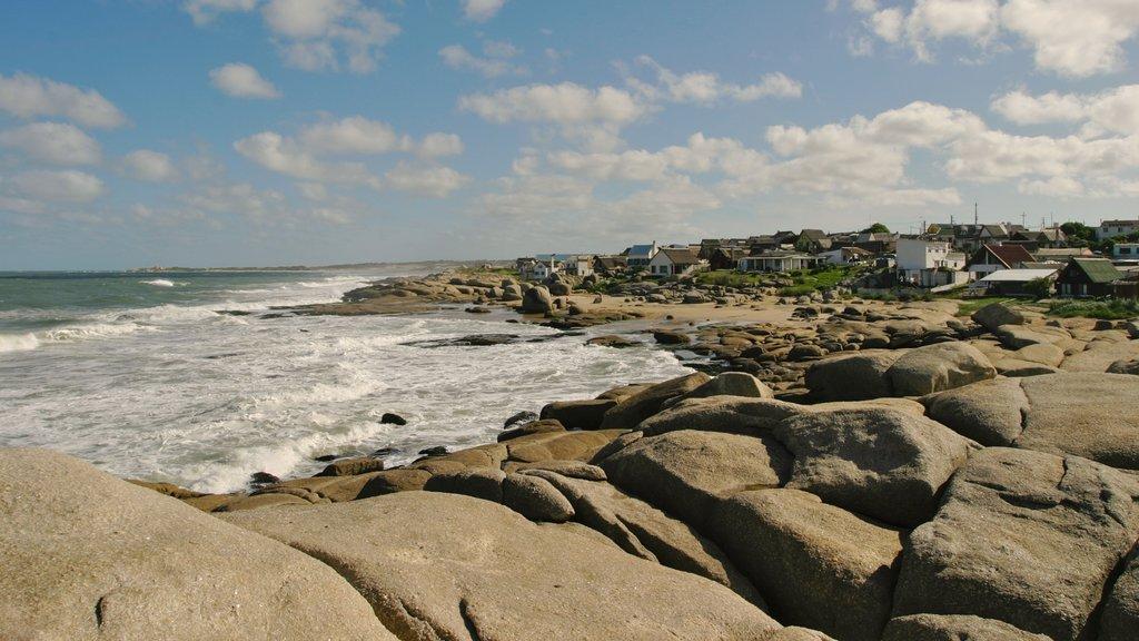 Punta del Diablo featuring rocky coastline and a coastal town