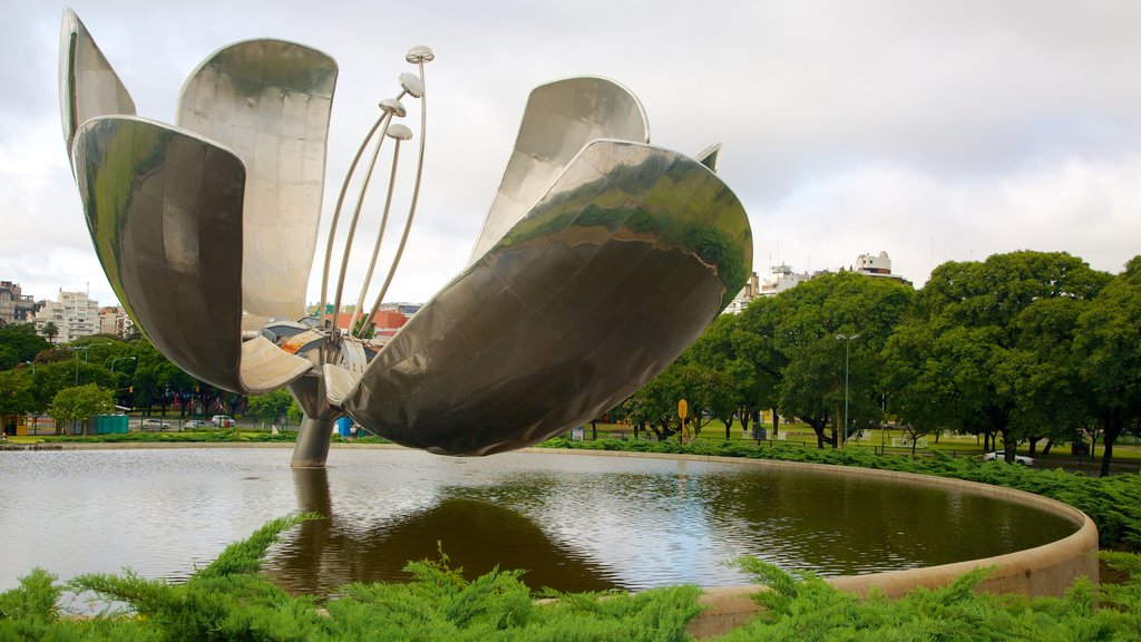 Buenos Aires showing outdoor art, a garden and a pond