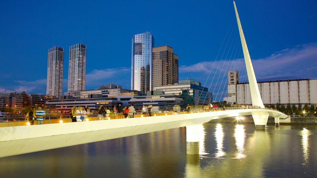 Puerto Madero which includes night scenes, a bridge and a river or creek