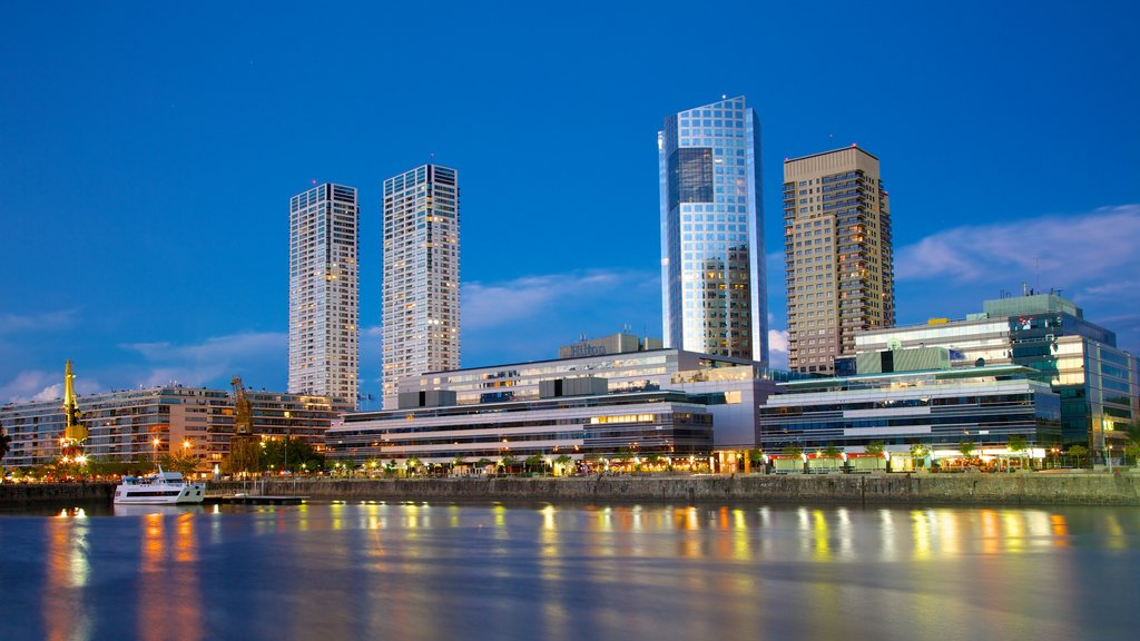 Puerto Madero showing modern architecture, night scenes and a city