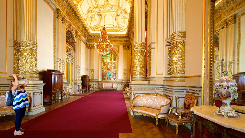 Teatro Colon featuring theater scenes and interior views as well as an individual femail