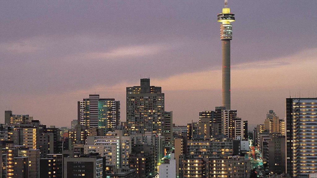Johannesburg - Gauteng which includes a sunset, modern architecture and a high rise building