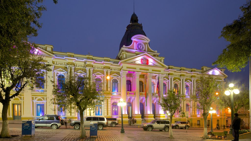 Plaza Murillo featuring a city, night scenes and heritage architecture