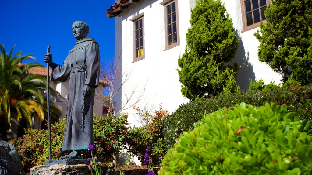 Mission San Rafael Arcangel featuring a statue or sculpture