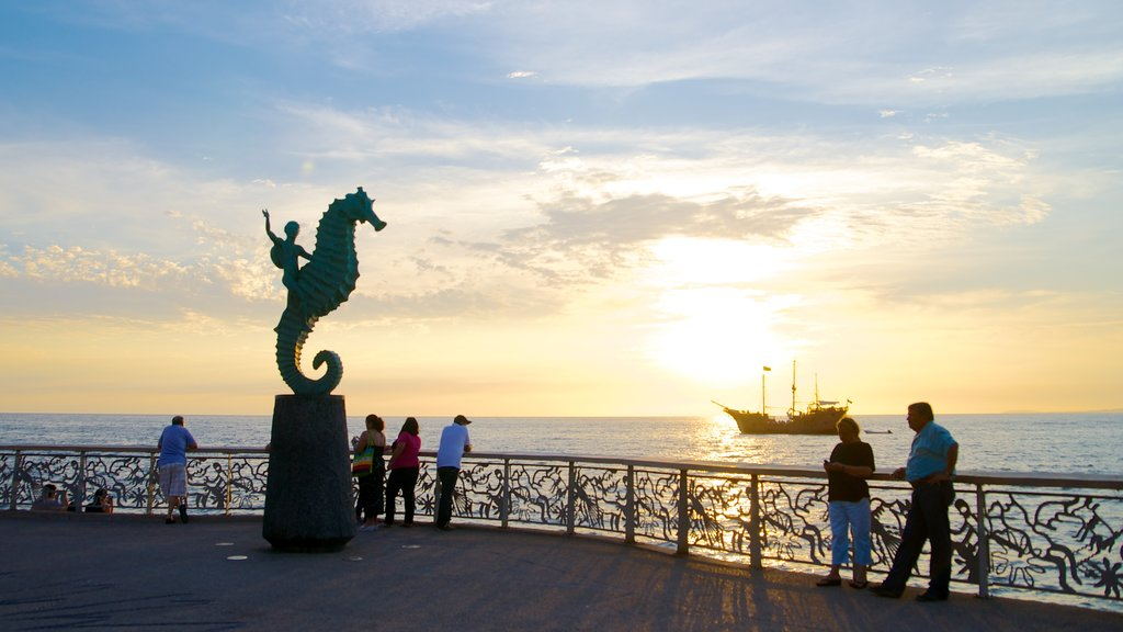 Malecon featuring views, a statue or sculpture and general coastal views