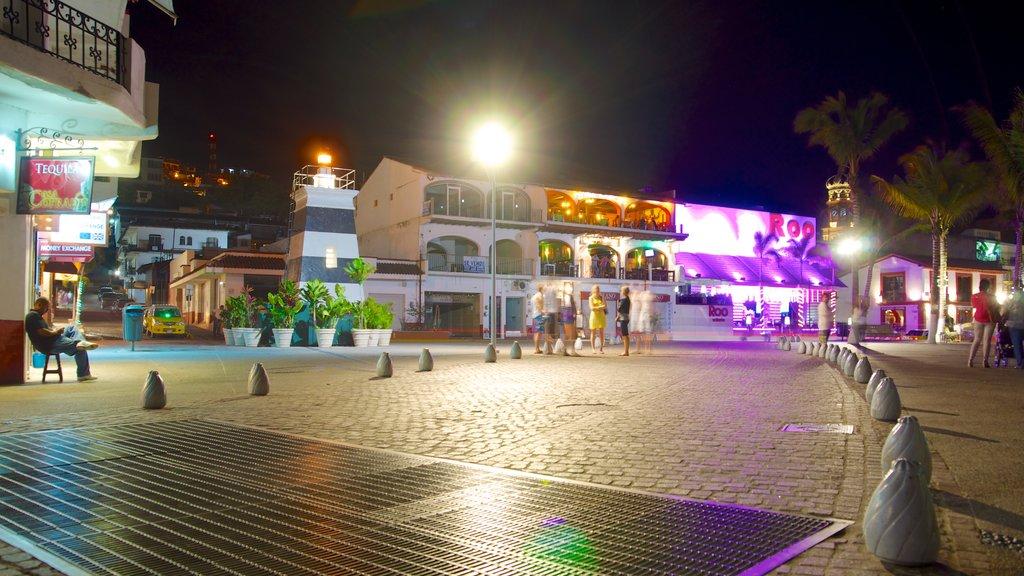 Malecon which includes night scenes and a square or plaza