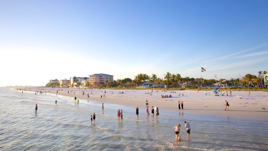 Fort Myers Beach showing a sandy beach and general coastal views as well as a large group of people