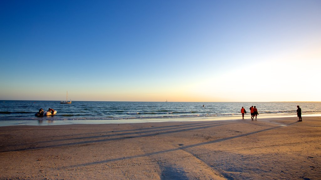 Fort Myers Beach which includes a sandy beach and a sunset