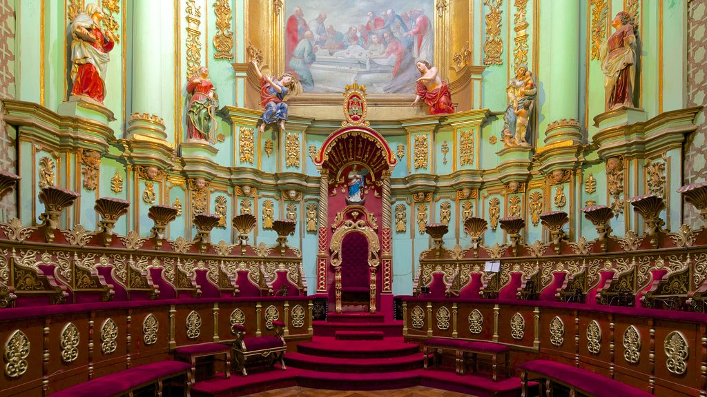Quito Cathedral which includes heritage architecture, religious elements and a church or cathedral