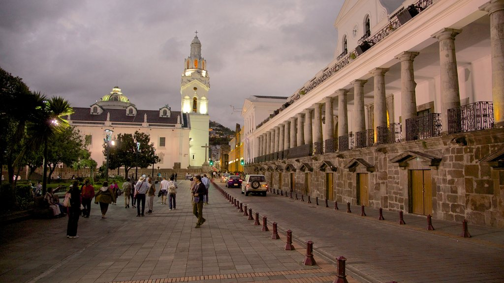 Quito Cathedral showing street scenes and night scenes as well as a large group of people