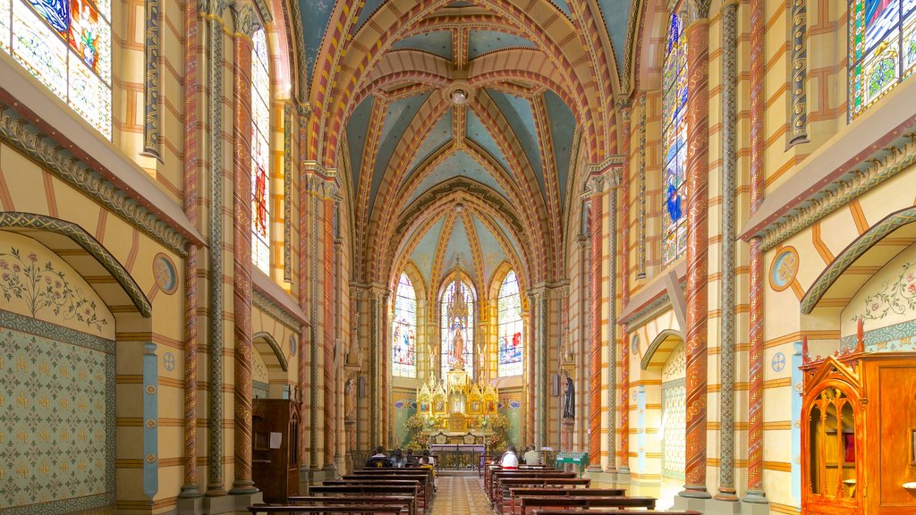 Basilica of the National Vow which includes interior views, religious aspects and a church or cathedral