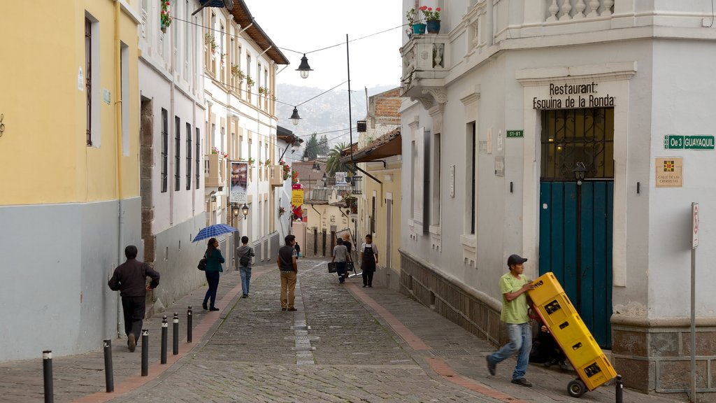 Calle La Ronda featuring street scenes as well as a large group of people