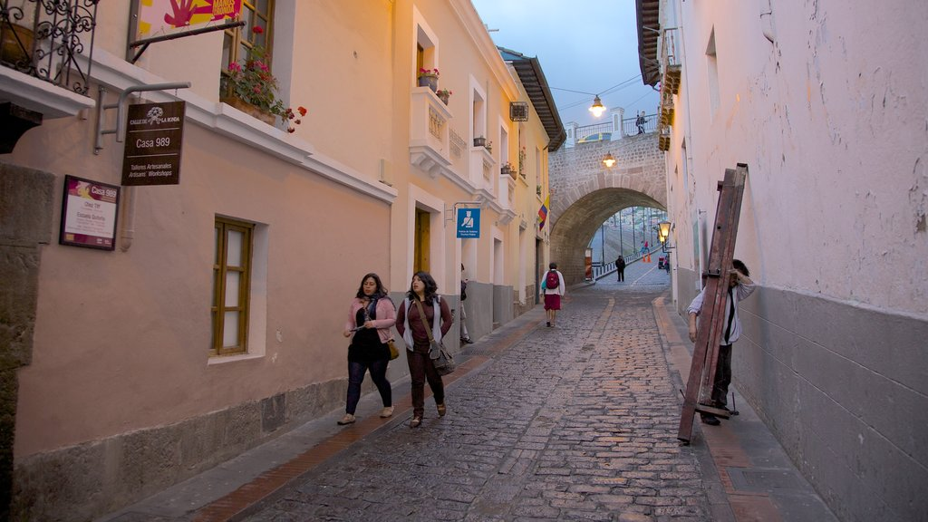 Calle La Ronda featuring street scenes as well as a small group of people