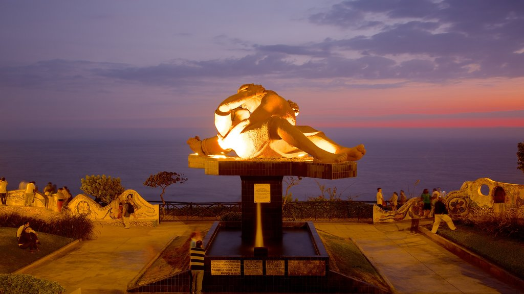 Parque del Amor which includes night scenes, a sunset and outdoor art