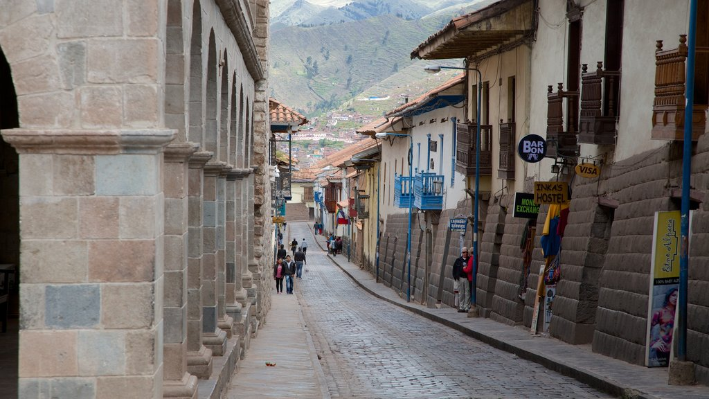 Cusco which includes street scenes
