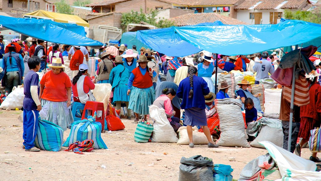 Urubamba featuring markets as well as a large group of people