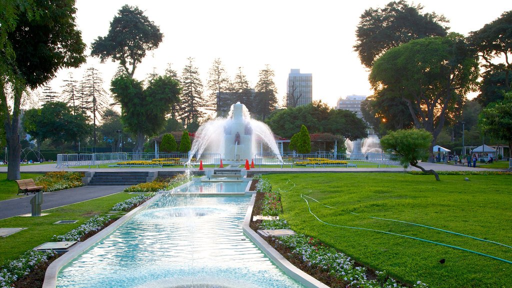 Exposition Park featuring a fountain, a pond and a garden