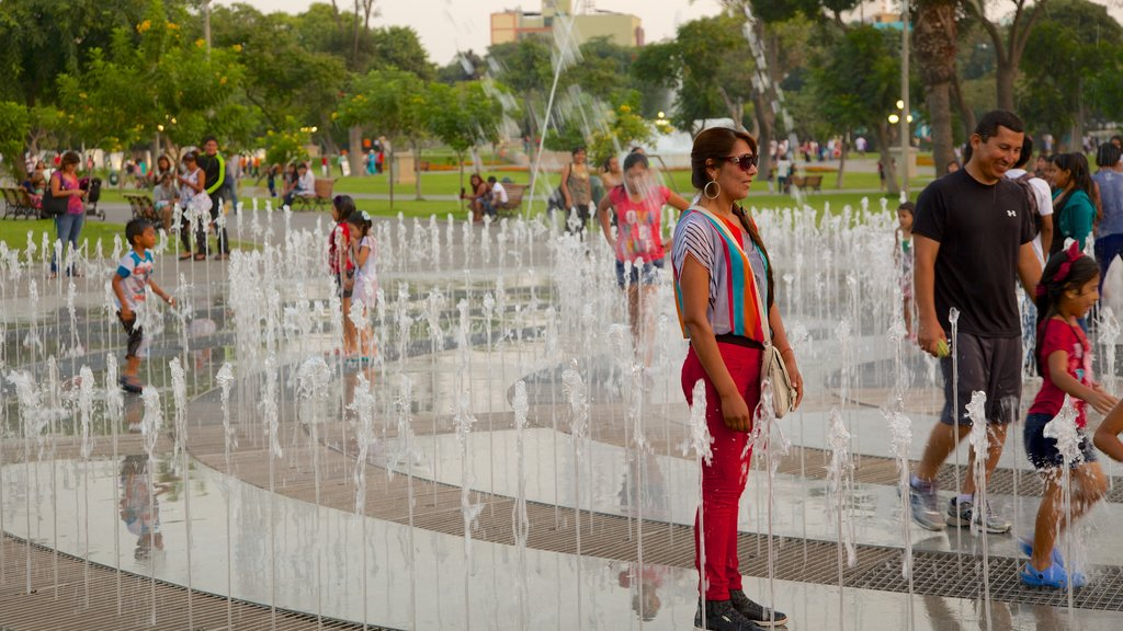 Exposition Park which includes a park and a fountain as well as a large group of people