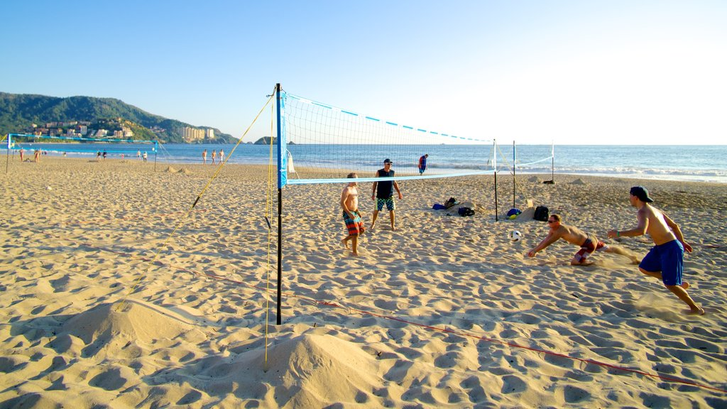 El Palmar Beach which includes a beach and general coastal views as well as a small group of people