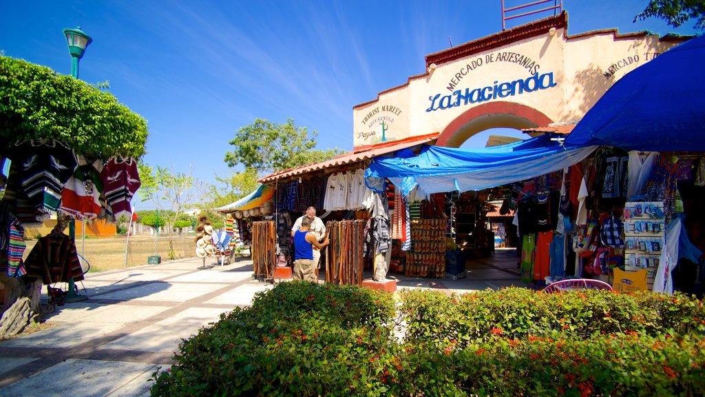 Ixtapa - Zihuatanejo featuring markets and street scenes