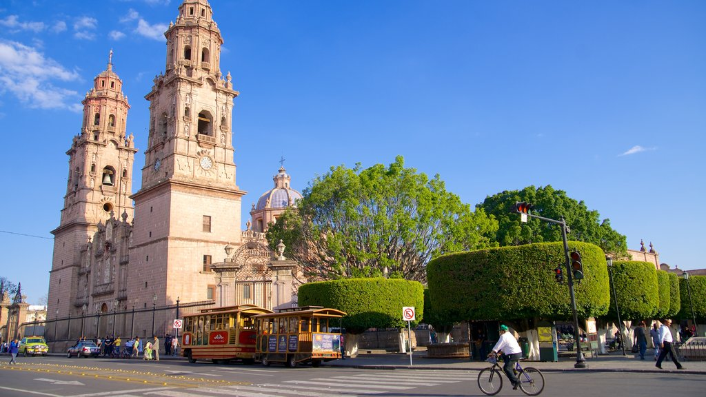 Morelia Cathedral which includes a church or cathedral and street scenes