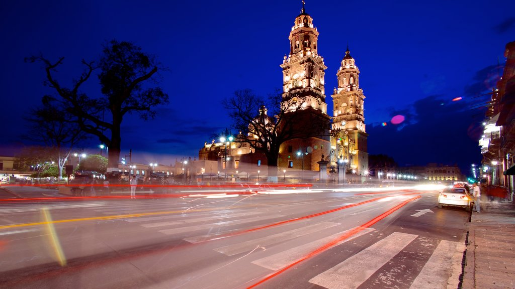 Morelia Cathedral showing night scenes, street scenes and a city