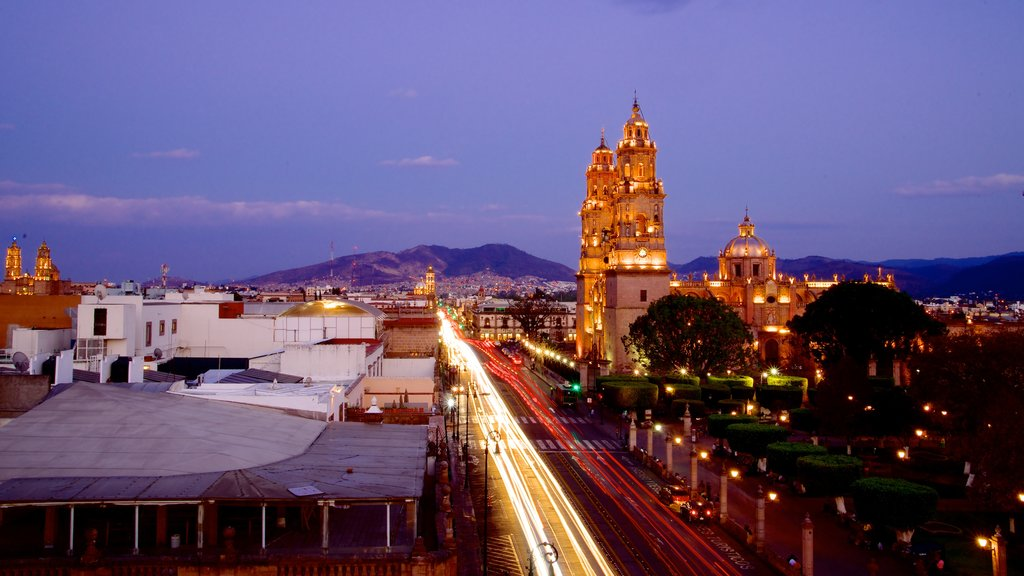 Morelia Cathedral which includes a city and night scenes