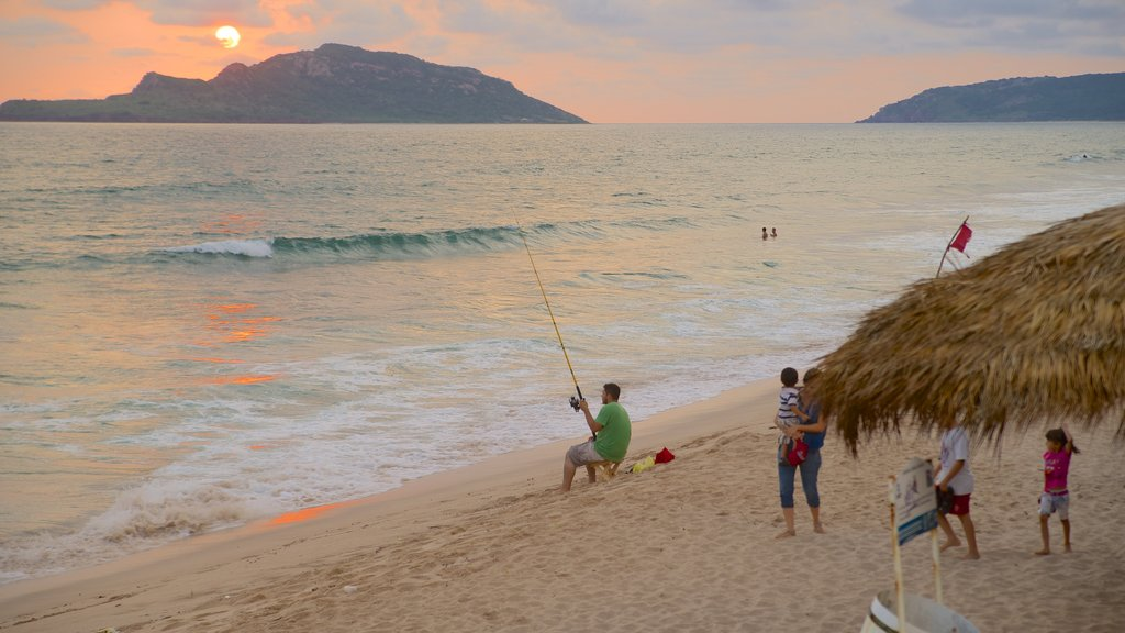 Mazatlan featuring fishing, a sunset and a beach