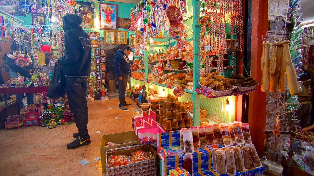 Basilica de Guadalupe featuring interior views and markets as well as a small group of people
