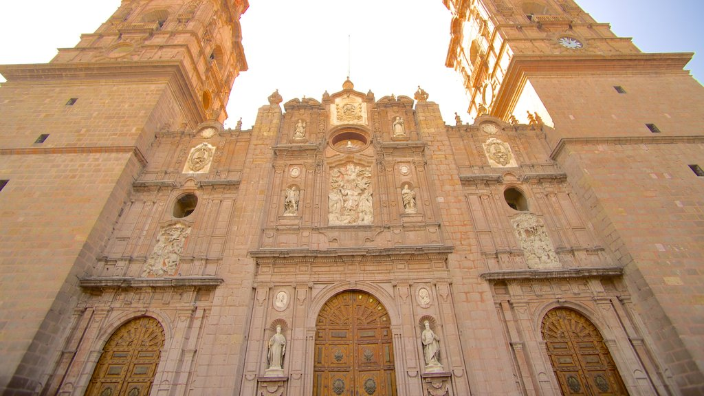 Bajio featuring heritage architecture and a sunset
