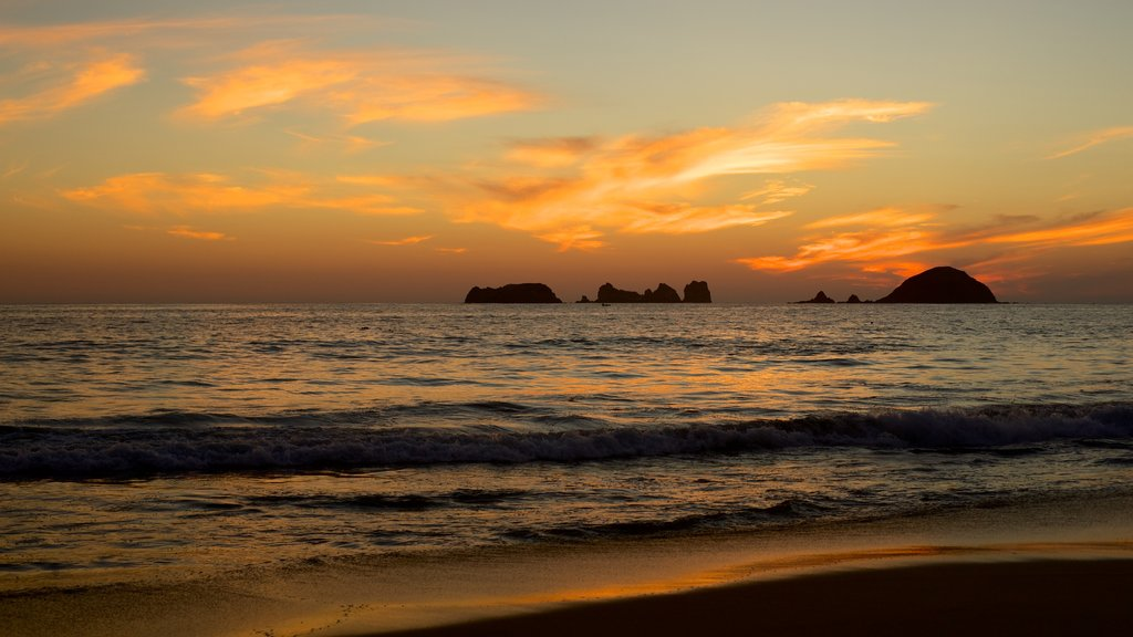 El Palmar Beach which includes general coastal views, a sandy beach and a sunset