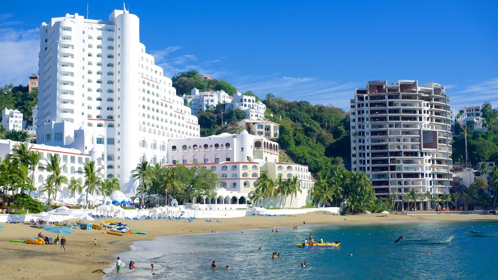 Playa La Audiencia showing modern architecture, tropical scenes and a luxury hotel or resort