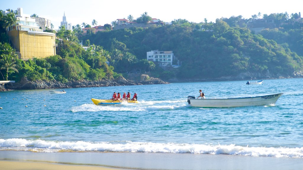 Playa La Audiencia which includes general coastal views, watersports and boating