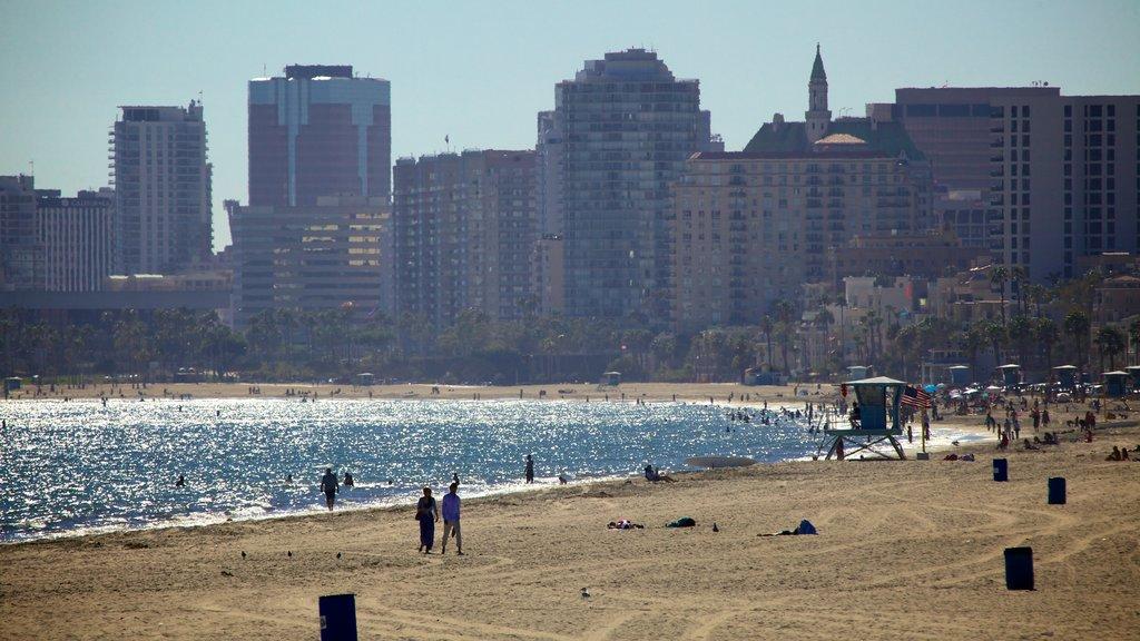 Long Beach featuring a sandy beach, a bay or harbor and a city