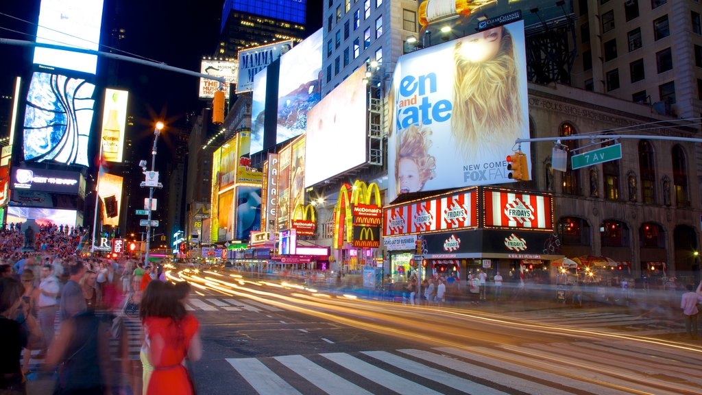 Times Square featuring a city, night scenes and street scenes