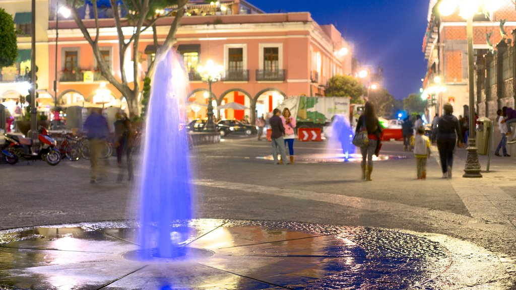 Puebla featuring night scenes, a square or plaza and a fountain