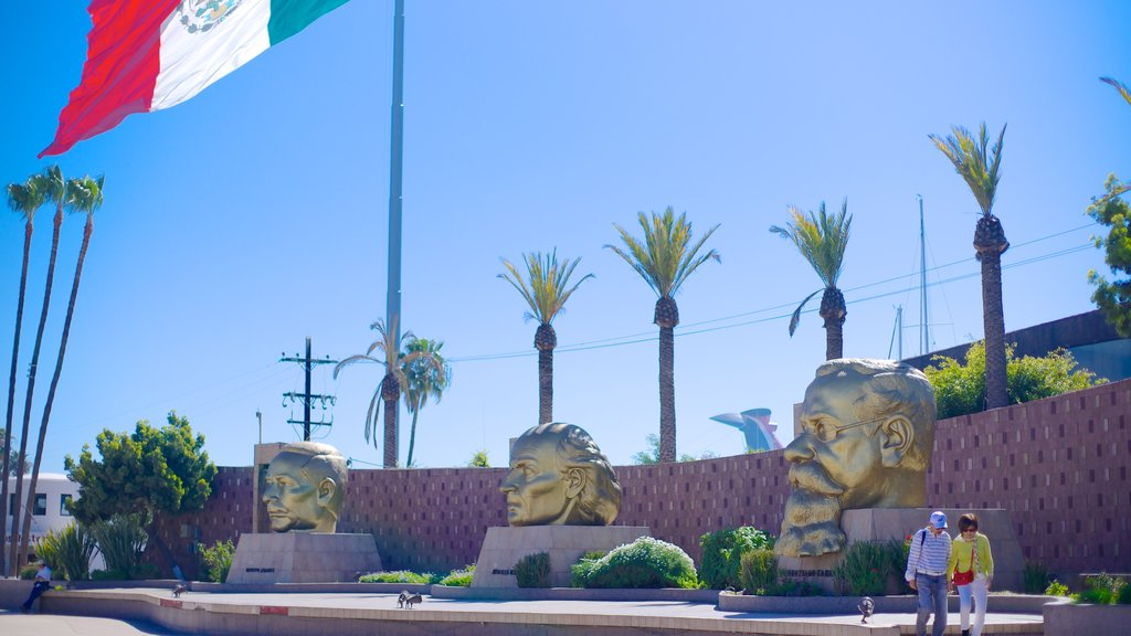 Ensenada which includes a statue or sculpture and outdoor art as well as a couple
