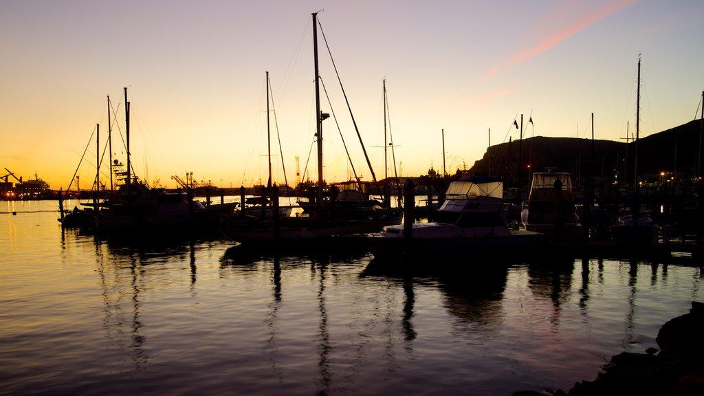 Ensenada which includes a coastal town, a sunset and a marina