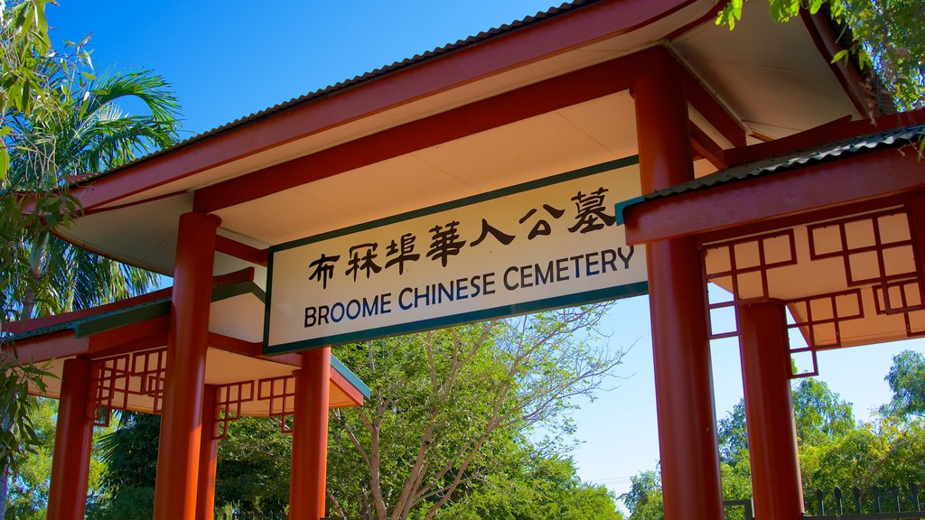 Broome featuring signage, a cemetery and religious elements