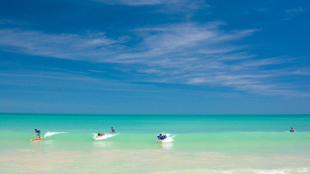 Cable Beach which includes general coastal views and surfing